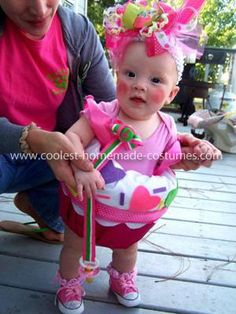 Homemade Baby Cupcake Costume: Cutest little Homemade Rosie the Riveter Costume! To make this costume, I bought a plastic flower pot from the Dollar store, I made sure the pot was deep