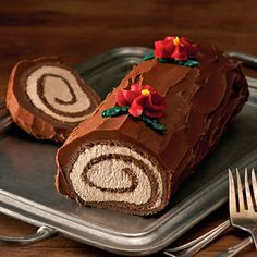 A rich chocolate roulade with sweet coffee cream filling and chocolate fudge frosting.