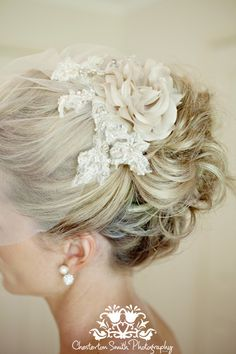 An elegant way to have your wedding hair done with a tulle blusher