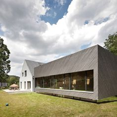 Diagonal strips of wood clad the exterior of this annexe that Franz Architekten has added to a house in Vienna to make room for extra family members.