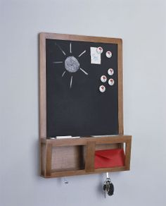 IKEA Fan Favorite: LUNS writing/magnetic board. Write messages with chalk and use magnets on the board. It's also perfect for keys, mail and mobile phones.