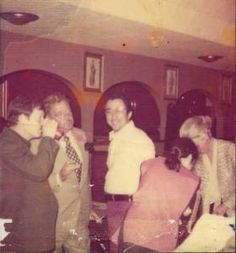 Jackie Gleason (second from left) talks with Chuck Ballas Sr. at Luigi's in 1975. Gleason went next door to Sports Center that night, took o...