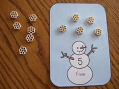"Print the cards.  Have the children identify the number and put the corresponding number of ""pasta snowflakes"" on each card from Making Learning Fun"