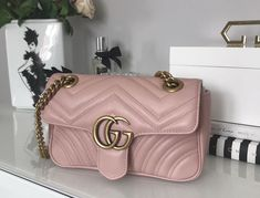 a1c6e408aa1 Product Line  Gucci Marmont. The mini GG Marmont chain shoulder bag has a  softly structured shape and an oversized flap closure with Double GG s.