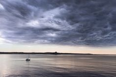 """Calm Seas, Stormy Skies - A dramatic cloud consumes the calm bay. <a href=""""http://www.aaronjenkin.co.uk/prints"""">Prints</a> <a href=""""https://www.facebook.com/aaronjenkinphotography"""">Facebook</a> <a href=""""https://www.flickr.com/photos/apjenkin/"""">Flickr</a> <a href=""""http://apjenkin.tumblr.com/"""">Tumblr</a> <a href=""""https://www.instagram.com/aaronjenkin/"""">Instagram</a>"""