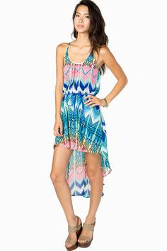 Go bold or go home. A chiffon hi-lo dress with a super colorful tribal printed body. Thin suede rope at waist. Lined.