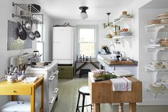 A 1950s refrigerator, a midcentury stove, an antique butcher block, and a salvaged cast-iron sink magnify this kitchen's farmhouse charm.