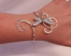 This is handmade dragonfly cuff bracelet made from silver plated metal with emerald swarovski crystals intricately woven together to create this lovely elven inspired cuff perfect to wear every day or to special events and weddings Check my other items to see the matching necklace and matching circlet It is also available in Gold. The cuff is adjustable and will fit most sizes, If you are still concerned it wont fit then just give me your exact measurements and I can make it in your size…