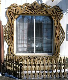 Wooden hand-carved window frame, city of Tomsk, Russia