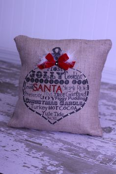 Christmas ornament burlap pillow from MonMellDesigns on Etsy.... I want it!