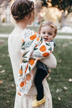 Clementine Swaddle by Clementine Kids Oh hello Clementine Kids! Oh Clementine! The swaddle just got a fruity update. This cotton muslin swaddle, with Cute Kids, Cute Babies, Baby Kids, Little Kid Fashion, Kids Fashion, Young Fashion, Fashion Hats, Fashion Brands, Kid Styles
