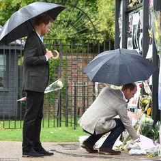 William and Harry take a few minutes to read messages and cards left behind in memory of their mother after their tour of the memorial garden today. William recently admitted that at the time of her death, he could not understand why the public were 'crying and wailing' when 'they didn't really know' his mother. But he added: 'Looking back, I have learned to understand what it was she gave the world and what she gave a lot of people'