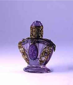 Vintage c1930 Jeweled Purple Mini Czech Perfume Scent Bottle in purple crystal with jeweled metal filigree and jeweled metal screw cap.  Height 2 inches.