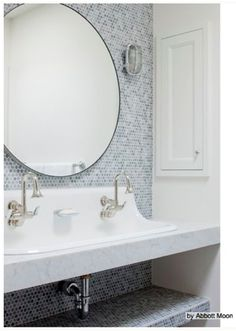 HALL BATH: Love the Kohler Brockway cast-iron sink with Cannock faucets and Cannock soap dish, Room & Board infinity round mirror, and recessed medicine cabinet. The sink sits on a countertop, with shelf underneath for towels or supplies. Tile is marble penny tiles.
