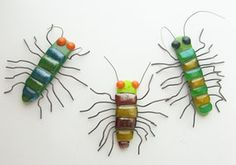 fused_glass_fridge_magnet_centipedes_by_trilobiteglassworks-d5e5fru.jpg 285×200 pixels