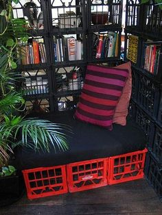 "These milk crate bookshelves serve two purposes.  One, they enable the teacher to keep an eye on the students so that kids can't just ""hide"" in the book corner and two, they show kids a great way to repurpose an everyday item that my just wind up in a landfill.  Cushions, interesting pillows and some plants make this a great reading station."
