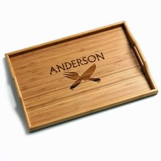 CARVING KNIFE PERSONALIZED BAMBOO TRAY - Serving tray looks just like wood but it is made of earth friendly renewable resource bamboo. Great for the table, countertop and breakfasts in bed! Tough as nails and moisture resistant. Beautifully laser engraved -up to 13 characters- at no additional charge. Measures 18 1/2 x 12 x 1 inch.