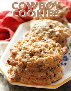 Laura Bush's Cowboy Cookies, also known as Texas Governor's  Mansion Cookies - these famous jumbo cookies are filled with oats,  chocolate chips, pecans, and coconut and are spectacular! You'll love  this half batch recipe for these soft and chewy cookies. Candy Recipes, Sweet Recipes, Cookie Recipes, Snack Recipes, Dessert Recipes, Recipe Foe, Recipe Ideas, Cowboy Cookies Laura Bush, Chocolate Chips