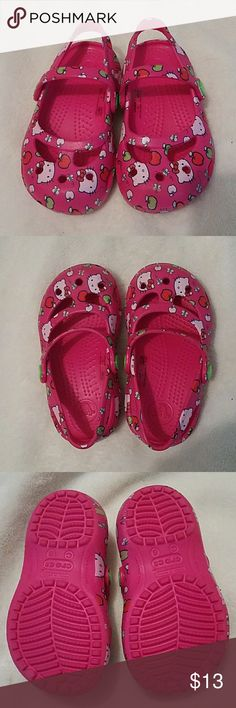 Hello Kitty Crocs Baby girl crocs with Hello Kitty, apples, and butterfly pattern. Super cute! My daughter never wore outdoors, only tried and worn for a few brief periods around the house. Excellent, practically new condition! CROCS Shoes Sandals & Flip Flops