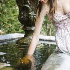 Inhibit algae growth in a garden pond with hydrogen peroxide treatments.