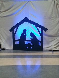 2014 Christmas stage design: Cardboard cutout manger silhouette and led light ba… – Christmas idea – Decoration Christmas Stage Decorations, Diy Christmas Costumes, Christmas Stage Design Backdrops, Ward Christmas Party, Christmas Service, Outdoor Nativity, Diy Nativity, Christmas Manger, Christmas Nativity Scene