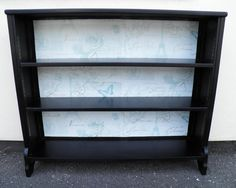 Upcycled Vintage Mahogany Bookcase.This very stylish vintage mahogany bookcase has been refinished in black, with decoupage decoration to the back panel. The wh