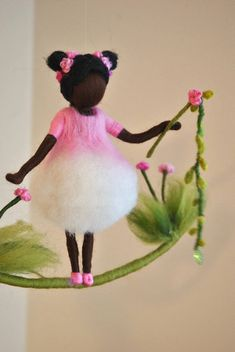 This is a Waldorf inspired piece made of wool by the needle-felting technique. Its been created to provide a peaceful and harmonious image that communicates with the soul through its colors, textures, forms and energy. Dimensions: 7in height, 11 in width. Doll: 7in. SHIPPING: Since