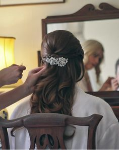 Wedding bridal hairstyle - curls with plaits pinned with vintage style brooch - http://www.nickisnicknackery.com