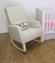 "Naptime nursery rocker in a natural finish with oatmeal linen fabric and XO ""hugs & kisses"" cushion.   From www.offyourrocker.ca."