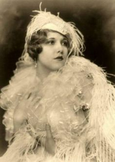 """Claudia Dell (January 10th 1910 - September 5th 1977), photographed by Alfred Cheney Johnston.  She appeared in the """"Ziegfeld Follies of 1927"""" and """"Rosalie"""".  She was the original model for the Columbia Pictures logo.  """"Claudia Dell was merely Claudia Dell Smith, of San Antonio, Texas, who came to new York to visit her aunt, vaudeville's Claudia Coleman. Aunt Claudia suggested she try the stage, just to see whether or not she liked it. And having nothing better t"""
