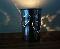 DIY tin lanterns... peel label off old tin, fill with water, freeze, draw on design, pierce with hammer and nail, thaw ice, wash off design and place tealight candle inside