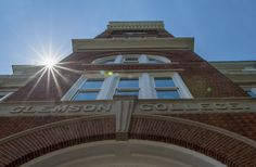 https://flic.kr/p/s5zYgX | Tillman Hall sun flare | The sun flares across the corner of Clemson University's Tillman Hall April 30, 2015. (Photo by Ken Scar)