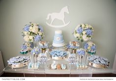 Rocking horse themed cake table for baby shower | Photographer: Nisha Ravji, Coordinating: White Door Events