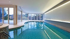 Indoor Swimming Pool Ideas - You want to build a Indoor swimming pool? Here are some Indoor Swimming Pool designs and ideas for you. Swimming Pool Photos, Small Swimming Pools, Luxury Swimming Pools, Swimming Pool Designs, Lap Swimming, Small Indoor Pool, Indoor Swimming Pools, Indoor Outdoor, Outside Pool
