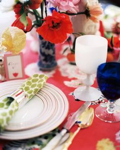 Entertaining Photo - A table set with green patterned napkins and a mixture of flatware and glassware