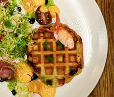 Lobster Waffles | A savory spin on the breakfast favorite, these waffles  are made with puff pastry and stuffed with succulent lobster tails and fresh herbs.
