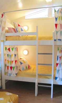 I love the idea of bunk bed curtains on regular bunk beds! Even love the IKEA pennants. Bright and cheery! House of Turquoise: Jane Coslick