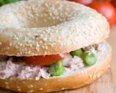 Scrumptious layers of tuna salad, green onions, and tomatoes are packed into this cool, creamy sandwich. While we made this sandwich with a sesame seed bagel, you can substitute it with your own bread of choice. Bagels, Sandwich Vegan, Salad Sandwich, Easy Tuna Salad, Healthy Summer Recipes, Wrap Sandwiches, Cottage Cheese, Healthy Cooking, Recipes