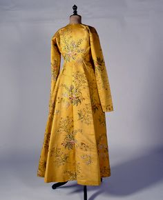 """""""Doulamas"""". Dress coat, (mid to late?)18th Century, from either Siphnos or Ios island, Greece, made of English yellow silk brocade. This type of dress coat was often trimmed with fur round the front opening."""