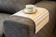 Do you like to drink coffee or eat your dinner in front of the TV? If yes, this unique sofa tray just for you. You no longer have to worry about spilled food. Buy your unique sofa tray today!  Measurements: 22.5 x 14 (57 x 35 cm). Fits every rectangular armrest.  Materials: • We use high-quality timber from ash tree that provides each sofa tray with a unique grain. Our wood is very durable and sourced from the local Estonian forests. • There's a genuine linen fabric on the back of the sofa…