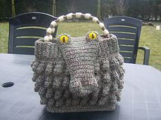 This makes me smile : )  Ravelry: Crocheted Alligator Handbag pattern by Marleen Hartog