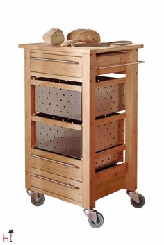 A useful bamboo & stainless steel trolley, equipped with handy drawers created by Brandani.