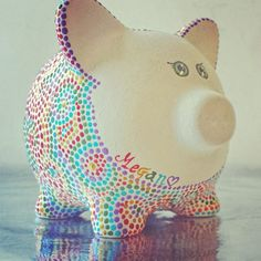 Piggy Bank Rainbow Piggy! Made to Order* Can be Personalized I painted him Sparkly white and then dot dot dotted...a Rainbow! I love this little guy! He is absolutely adorable! His cute little piggy body covered in sparkly dots and his giggling eyes make this guy so deliciously adorable! (dont eat him!) He is a little ceramic pig that I primed and painted... One little sparkly dot at a time w/ my tiny little brush. Oh my goodness... I am a sucker for an adorable pig! Measures: From tail to…