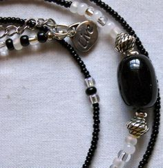 #waistbeads #rootsnculture #keffigal Single Strand: Large Onyx, two sizes of black, two shades of white frosted, two shades of transparent seed beads with metal accents.