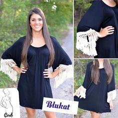 Black Dress/Top w/White Fringe. Black Dress or Long Top with White Fringe hanging from Sleeve. Wear as a dress or long top. Have Small, & Medium. Large/Sold! This runs a little big. Cotton material. Cycle Boutique Dresses