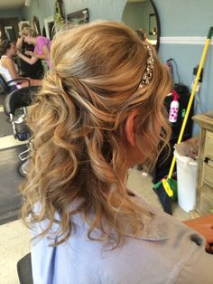This is a gorgeous half up formal hair style done on medium length and thickness hair with layers.