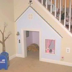 Dog house under the stairs -- I like the idea of having a little window! so dog can share with kids too lol