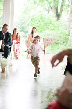 ring bearer with a sign | Nancy Ray #wedding