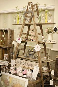 """Vintage Ideas This ladder display is the perfect visual to show how to """"pyramid"""" in your store. More - Today we're throwing it back with some adorable vintage wedding ideas. We're loving everything about this rustic wedding inspiration today. Design Shop, Flower Shop Design, Store Design, Ladder Display, Ladder Shelves, Window Shelves, Decoration Vitrine, Wedding Fair, Wedding Ideas"""