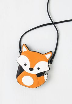 Critter-cal Mass Bag in Fox. For your bike ride tonight, you need a look thats both functional and fabulous. #orange #modcloth